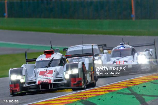 Audi Sport Team Joest R18 etron quattro Le Mans Prototype race car driven by FÄSSLER M LOTTERER ATRÉLUYER B driving through Bust Stop Chicane with a...