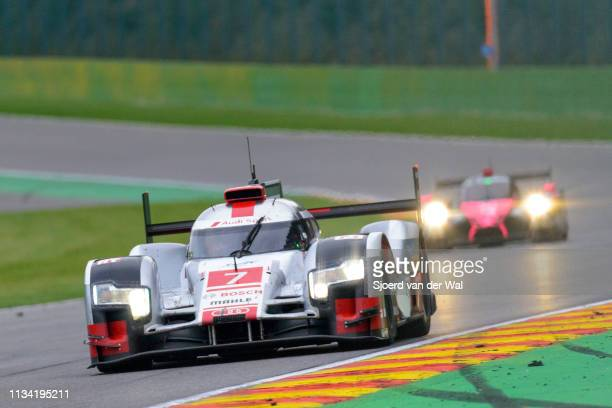 Audi Sport Team Joest R18 etron quattro Le Mans Prototype race car driven by FÄSSLER M LOTTERER ATRÉLUYER B driving through Bust Stop Chicane on...
