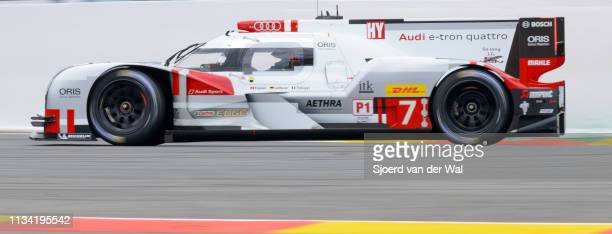 Audi Sport Team Joest R18 etron quattro Le Mans Prototype race car driven by FÄSSLER M LOTTERER ATRÉLUYER B driving through La Source Hairpin on...