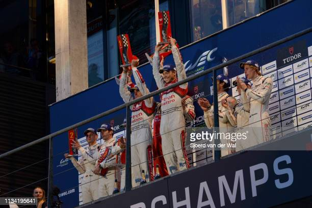 Audi Sport Team Joest racing drivers Andre Lotterer Benoit Treluyer and Marcel Fassler celebrating their victory on the podium during the 6 Hours of...