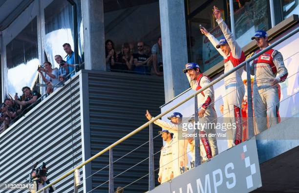 Audi Sport Team Joest racing drivers Lucas di Grassi, Loïc Duval and Oliver Jarvis posing for photographers after winning the 6 Hours of...