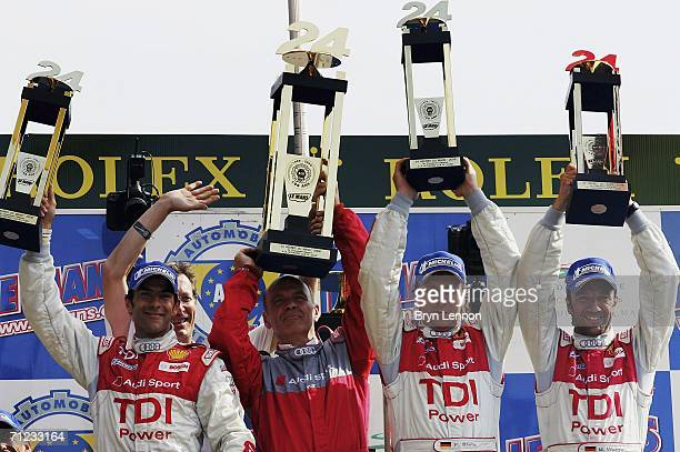 Audi Team mates Emanuele Pirro of Italy Frank Biela and Marco Werner celebrate winning the Le Mans 24h race on June 18 2006 at the Circuit des '24...