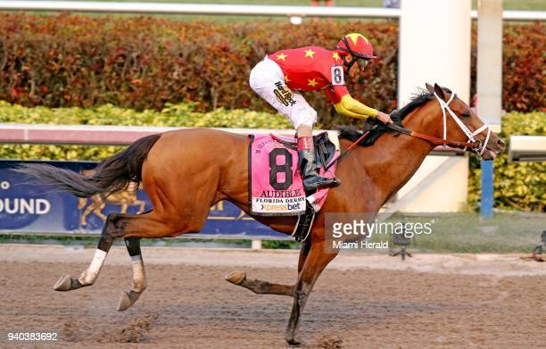 Audible with John R Velazquez up crosses the finish line to win at the Florida Derby at Gulfstream Park in Hallandale Fla on Saturday March 31 2018