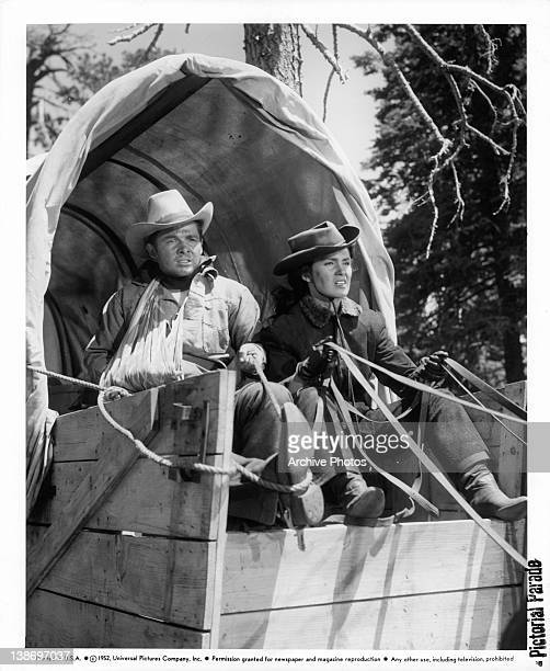 Audie Murphy and Gail Storm riding in a stage coach in a scene from the film 'The Kid From Texas' 1950