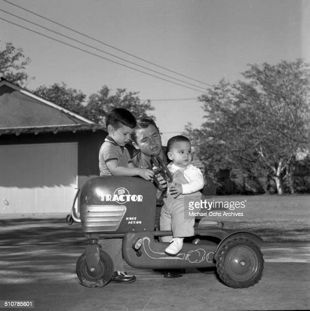 Audie Murphy poses with sons Terry and James in PerrisCA