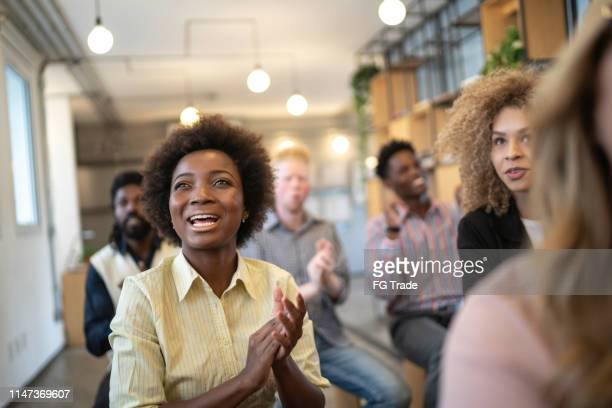 audience applauding a great speaker at business convention and presentation - education building stock pictures, royalty-free photos & images