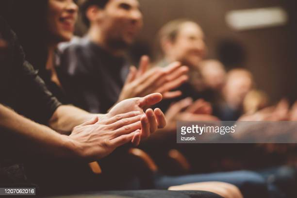 audience applauding in the theater - applauding stock pictures, royalty-free photos & images
