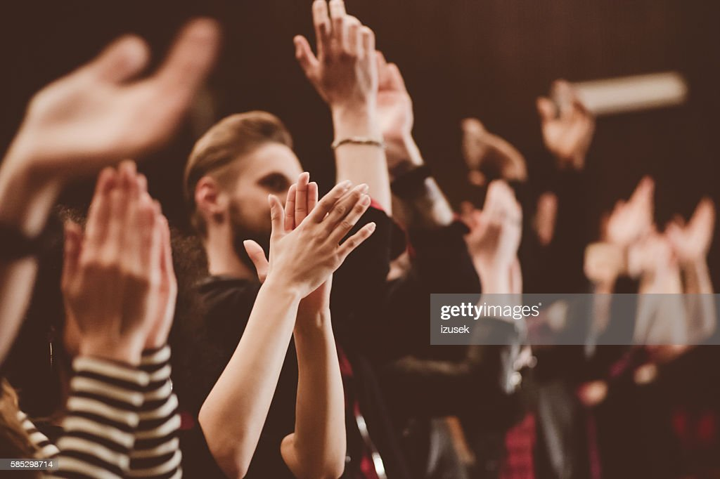 Audience applauding in the theater : Stock Photo