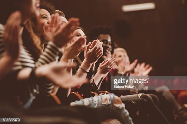 audience applauding in the theater - titta bildbanksfoton och bilder