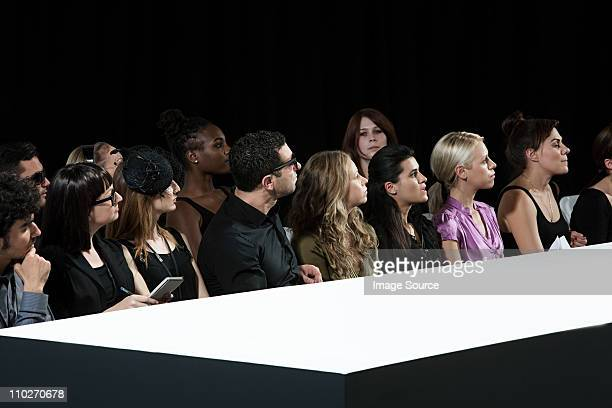 audience at fashion show watching empty catwalk - fashion runway stock pictures, royalty-free photos & images