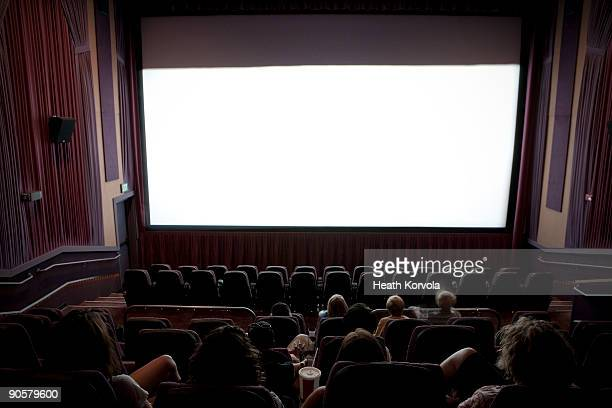 audience at movie theater. - projection screen stock pictures, royalty-free photos & images