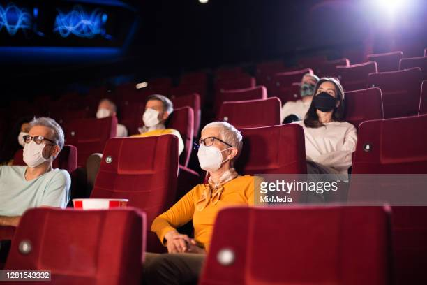 audience at the cinema wearing protective face masks - film premiere stock pictures, royalty-free photos & images
