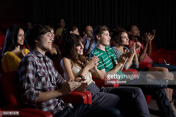Audience clapping in movie theater