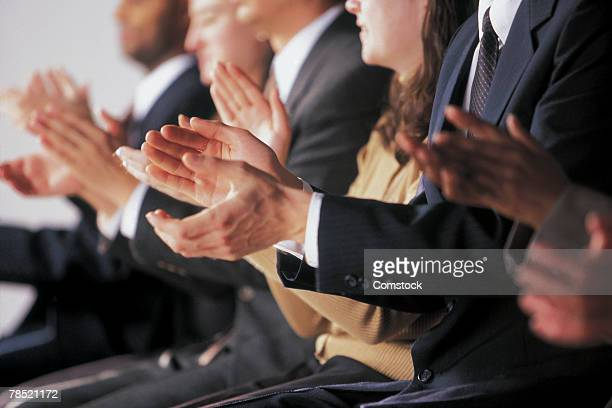 audience clapping - applauding stock pictures, royalty-free photos & images