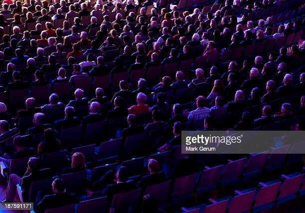 audience crowd at a presentation event - presentation stock pictures, royalty-free photos & images