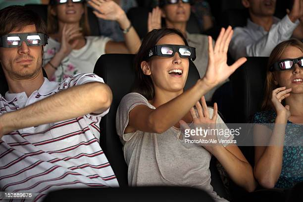 audience enjoying 3-d movie in theater - redoubtable film stock photos and pictures