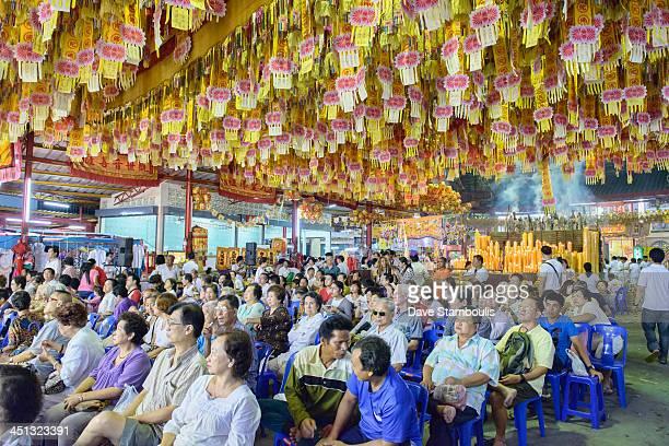 Audience enjoying a Chinese opera performance at the Vegetarian Festival in Bangkok, Thailand