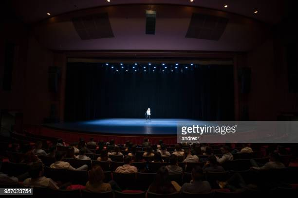 audience enjoying a singing performance on stage - performance stock pictures, royalty-free photos & images