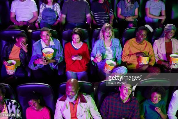 audience enjoying at theater - abgelenkt stock-fotos und bilder