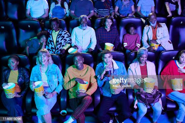 audience enjoying comedy movie - industria cinematografica foto e immagini stock