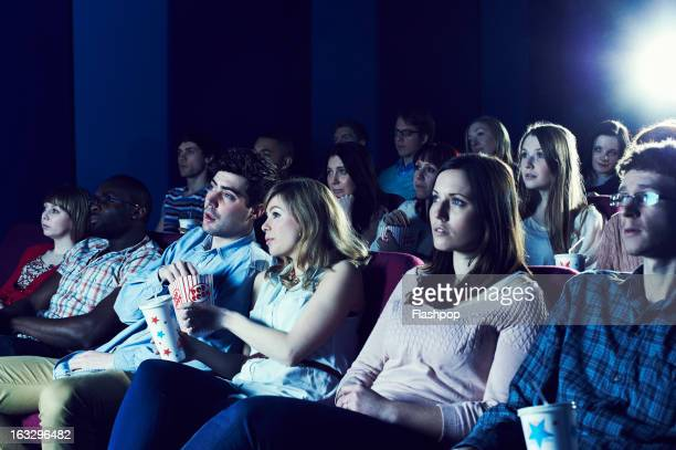 audience enjoying movie at the cinema - adult movies stock pictures, royalty-free photos & images