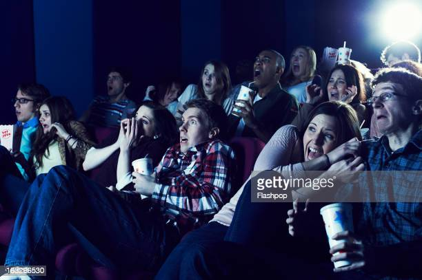 audience enjoying movie at the cinema - her 2013 film stock photos and pictures