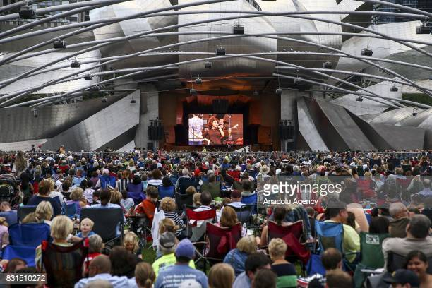 Audience gather at the Millennium Park as musical bands performs on Pritzker Pavilion stage as part of the 'Free Broadway In Chicago Concert' in...
