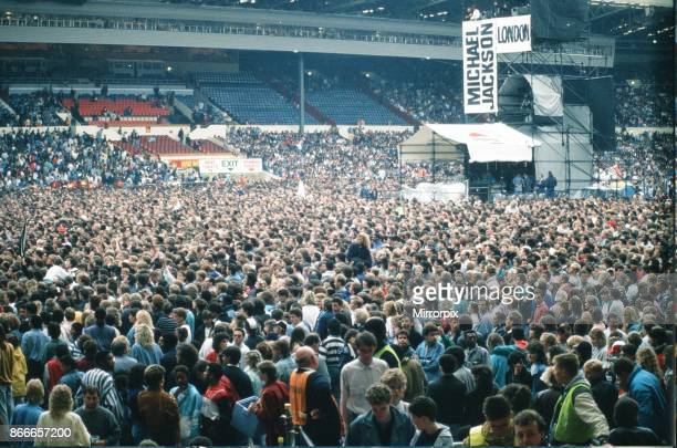 Audience gather outside the Wembley arena prior to the Michael Jackson concert 15th July 1988