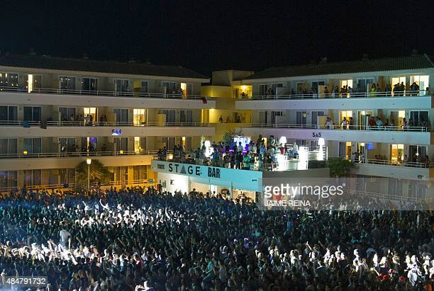 Audience have fun during French artist David Guetta performace in a resort of Magaluf in Calvia town on Mallorca island on August 21 2015 AFP PHOTO /...