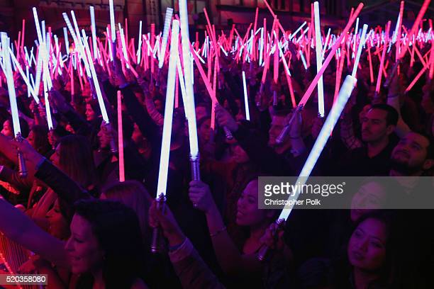 Audience holds up lightsabers during the announcement of 'Star WarsThe Force Awakens' as the Movie of the Year winner during the 2016 MTV Movie...