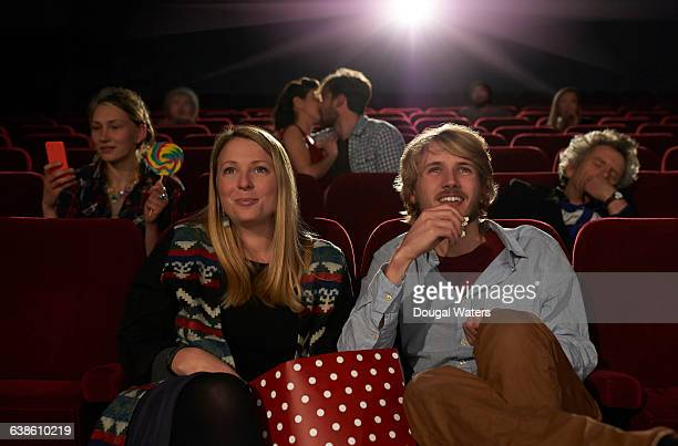 audience in movie theatre. - film industry stock pictures, royalty-free photos & images