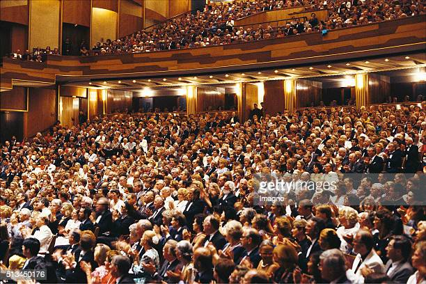 Audience in the auditorium of the Großes Festspielhaus in Salzburg circa 1985 By Harry Weber