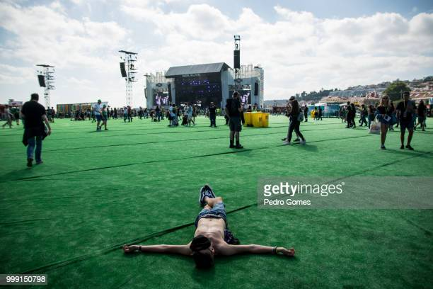 Audience member sunbathes during day 1 of NOS Alive festival on July 12 2018 in Lisbon Portugal