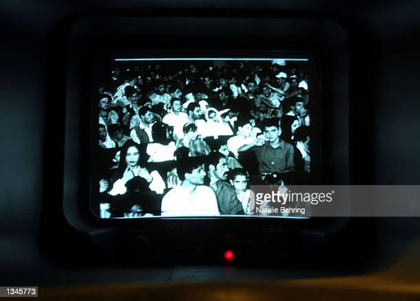 Audience members are seen through the view finder of a film camera during the taping of Afghanistan's most popular game show 'Test Your Brain' or...