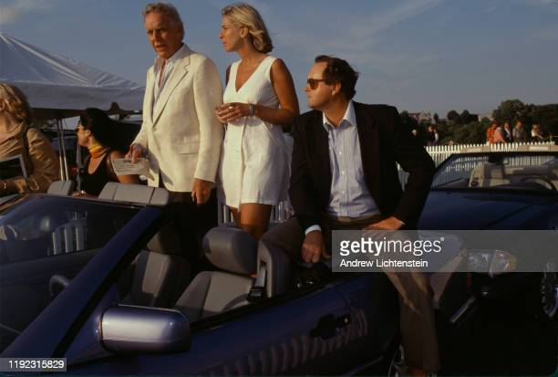 Audience members arrive to watch polo games and socialize at the Bridgehampton Polo Grounds in August of 1997 in Bridgehampton, Long Island, New York.