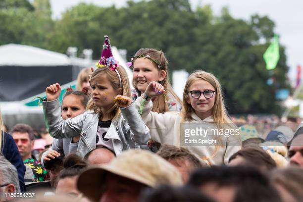 Audience members enjoying Isle of Wight Festival 2019 at Seaclose Park on June 16 2019 in Newport Isle of Wight