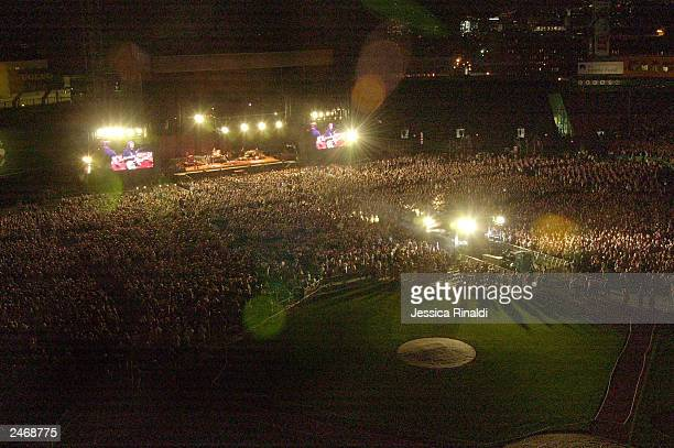 Audience members gather to see Bruce Springsteen and The E Street Band perform during the first night of Bruce Springsteen's concert series at Fenway...