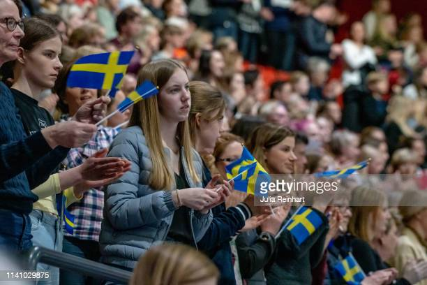 Audience members hold their breath as Swedish rider Peder Fredricson on Catch Me Not S rides to third place in the Longines FEI Jumping World Cup...