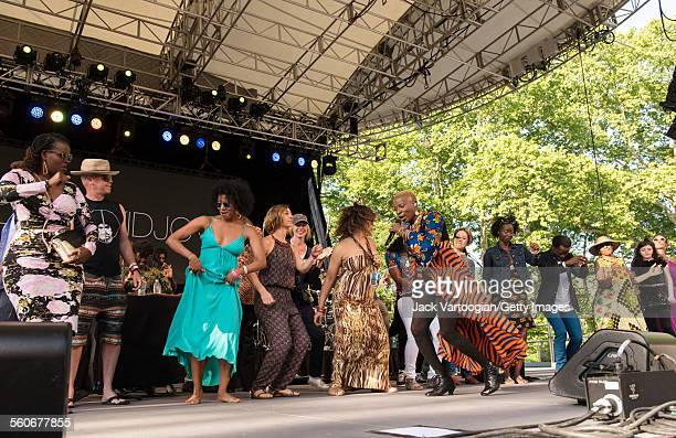 Audience members join Benineseborn American musician Angelique Kidjo as she performs onstage at Central Park SummerStage New York New York June 7 2015
