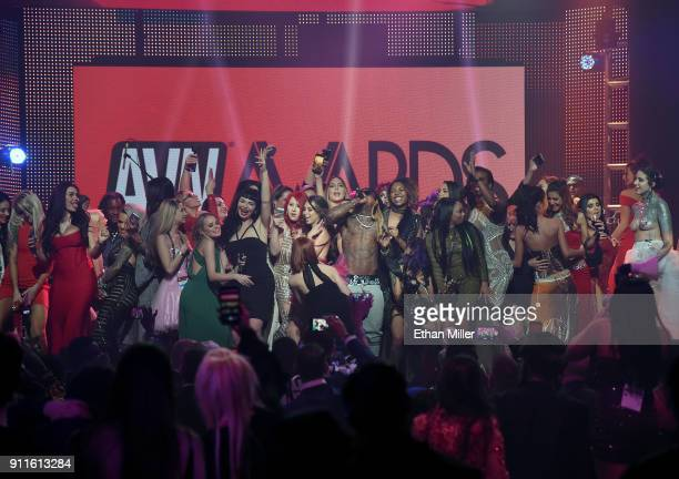 Audience members join rapper Lil' Wayne onstage as he performs during the 2018 Adult Video News Awards at The Joint inside the Hard Rock Hotel Casino...