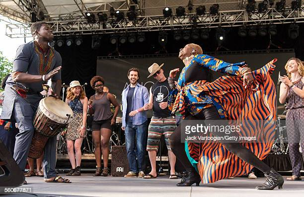 Audience members join Senegalese percussionist Magatte Sow who plays djembe and Benineseborn American musician Angelique Kidjo as they perform...