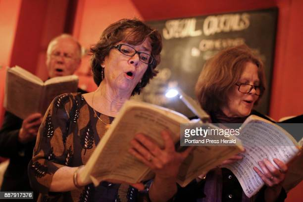 Audience members Kathleen Egan center left and Andrea Rosenberg sing during the third annual Barroom Messiah on Saturday at Blue A 5person orchestra...
