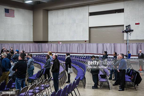 Audience members listen as Republican presidential candidate Donald Trump speaks at a campaign rally at the Ramada Waterloo Hotel and Convention...