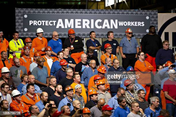 Audience members listen as US President Donald Trump not pictured speaks at the US Steel Corp Granite City Works facility in Granite City Illinois US...