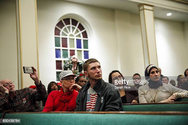 Audience members listen to questions at a town hall meeting with US Rep Keith Ellison at the Church of the New CovenantBaptist on December 22 2016 in...