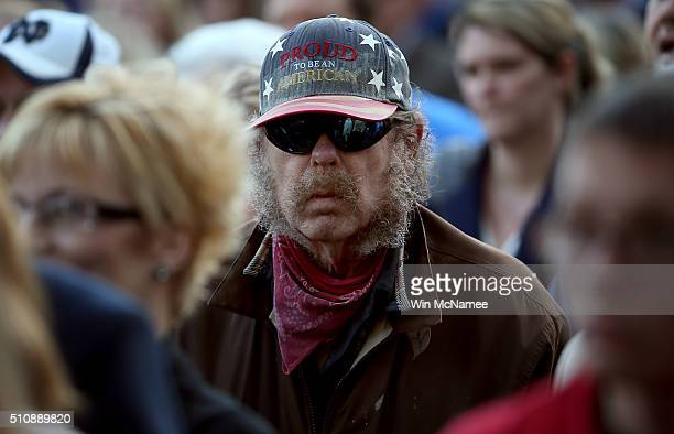 Audience members listen to Republican presidential candidate Donald Trump deliver remarks on February 17 2016 in Walterboro South Carolina Trump...