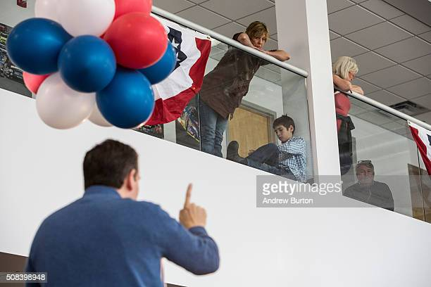 Audience members listen to Republican presidential candidate Sen Ted Cruz speak at a town hall meeting at a Toyota dealership on February 4 2016 in...