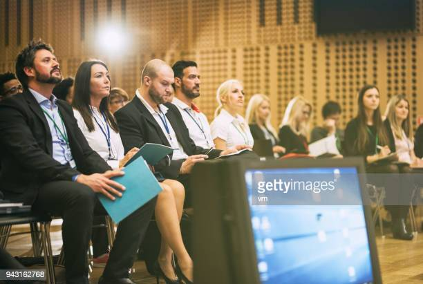 audience members listening to a lecture - attending stock pictures, royalty-free photos & images