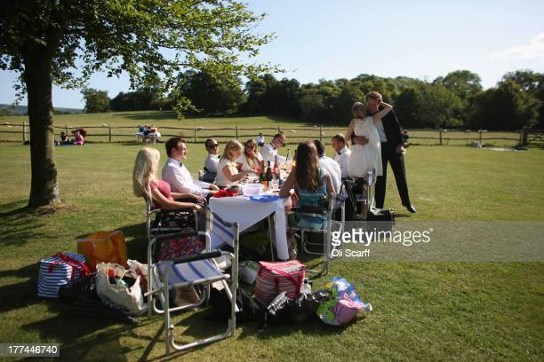 Audience members picnic in the grounds of Glyndebourne opera house before a production of the Benjamin Britten opera 'Billy Budd' on August 22 21013...