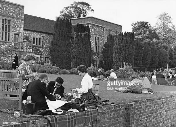 Audience members picnicking in the grounds of Glyndebourne House during the Glyndebourne Festival Opera, East Sussex, circa 1960.